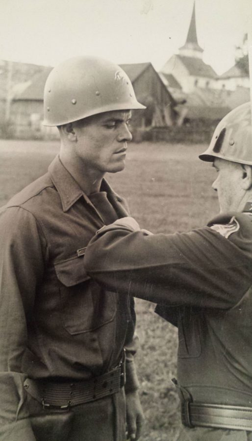 Maj. Gen. E. N. Harmon awards the distinguished service cross to S/Sgt. Rex D. Clark